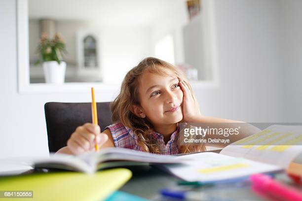 a 7 years old girl doing her homework - 8 9 years stock pictures, royalty-free photos & images
