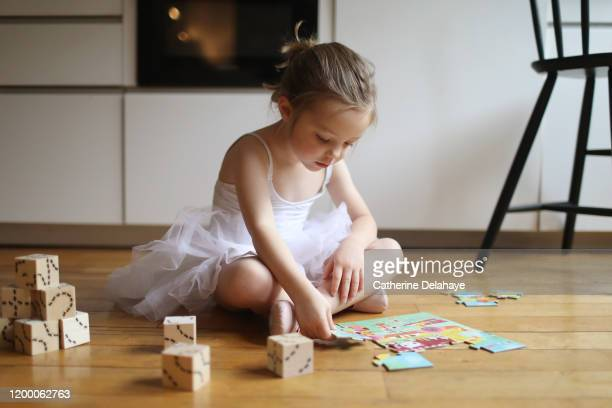 a 4 years old girl dressed as a dancer, playing in the kitchen - 4 5 years stock pictures, royalty-free photos & images