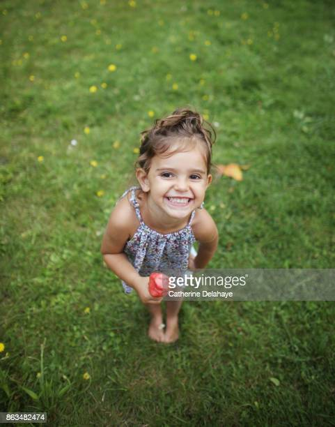 a 3 years old girl eating icecream in the garden - 2 3 years stock pictures, royalty-free photos & images