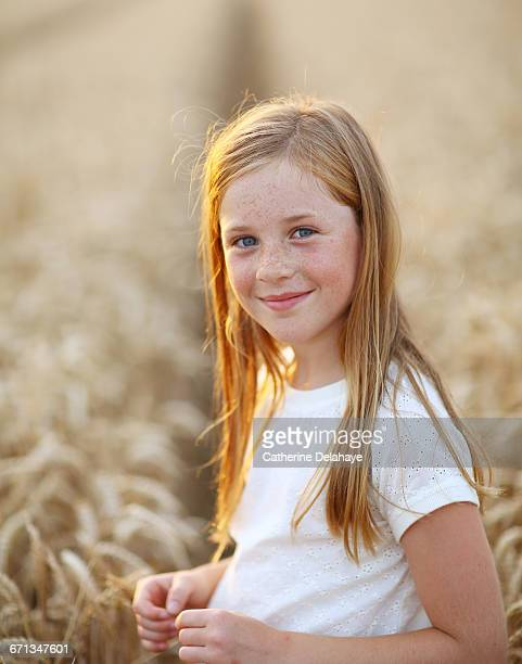 a 8 years old girl in a wheat field - 8 9 years stock pictures, royalty-free photos & images
