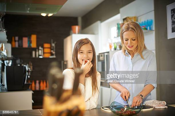 11 years old girl in kitchen with her mother