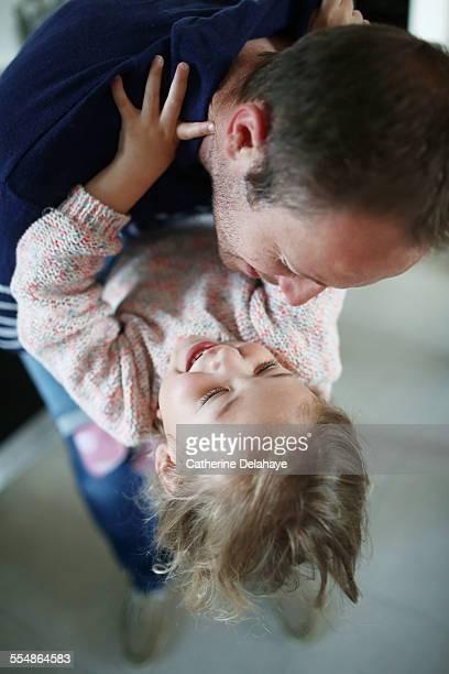 A 3 years old girl in the arms of her dad