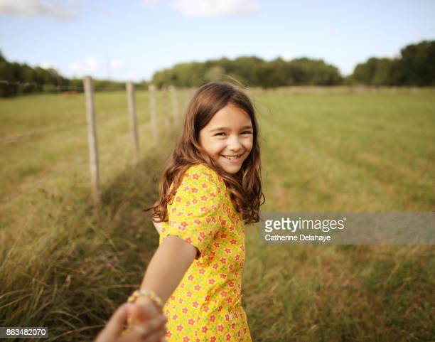 A 8 years old girl in the countryside