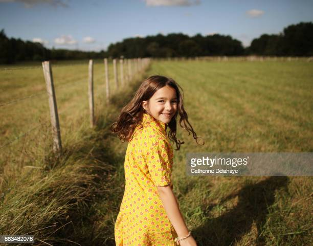 a 8 years old girl in the countryside - children only stock pictures, royalty-free photos & images