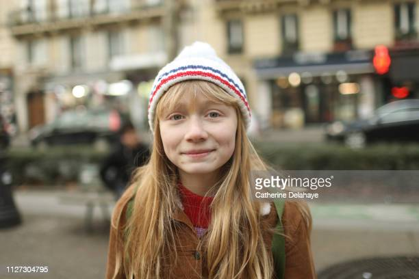 A 12 years old girl in the streets of Paris