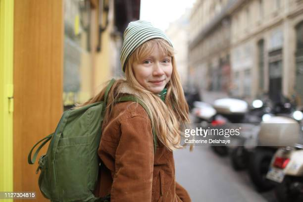 a 12 years old girl in the streets of paris - 12 13 years stock pictures, royalty-free photos & images