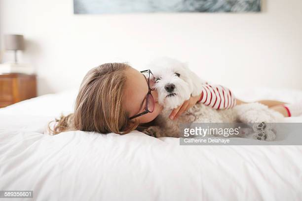 a 10 years old girl kissing her dog - delahaye stock photos and pictures