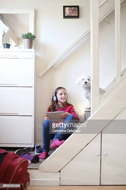 a 10 years old girl listenning music - 10 11 years stock pictures, royalty-free photos & images