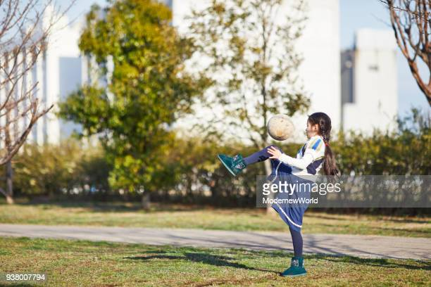 7  years old girl playing with ball_02 - 6 7 years stock pictures, royalty-free photos & images