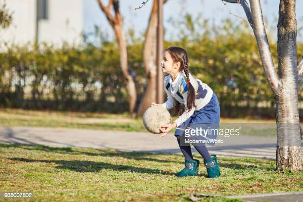 7  years old girl playing with ball_03 - 6 7 years stock pictures, royalty-free photos & images