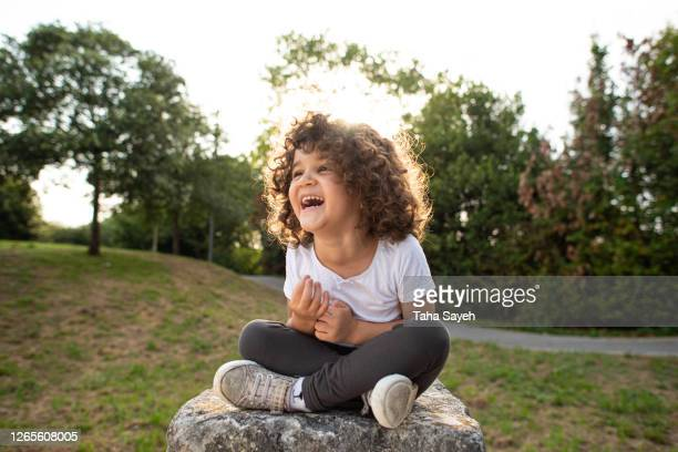 4 years old girl playing yoga and meditation. - 4 5 years stock pictures, royalty-free photos & images