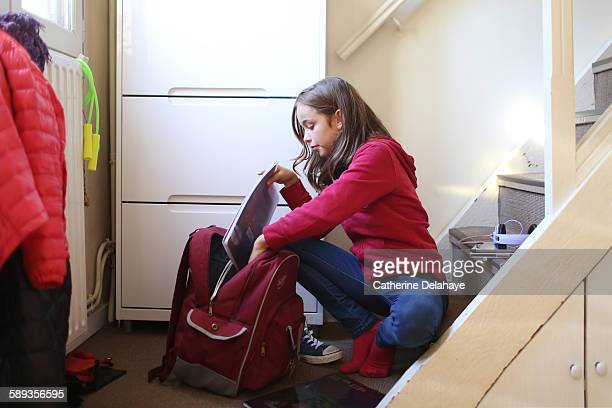 A 10 years old girl preparing to go to school