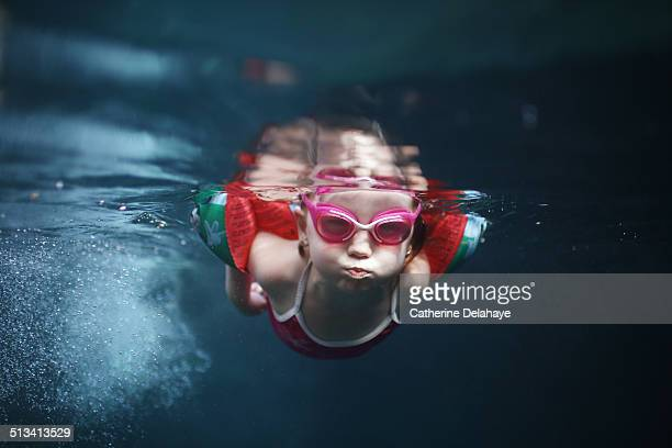 A 4 years old girl swimming under water