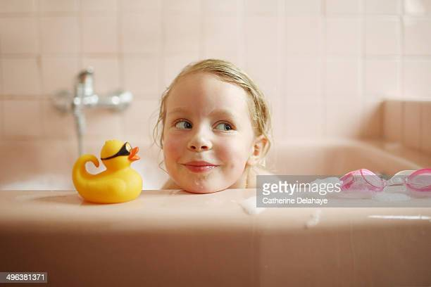 A 5 years old girl taking her bath