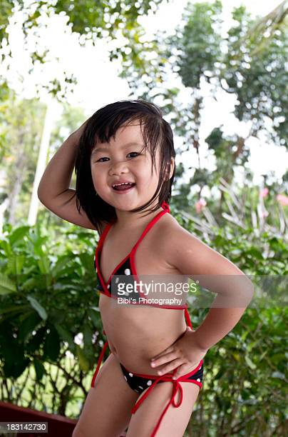 4 years old girl waring a tiny bikini - 4 5 years photos stock pictures, royalty-free photos & images