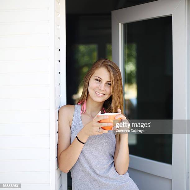 a 14 years old girl with a bowl in her hands - 14 15 years stock pictures, royalty-free photos & images