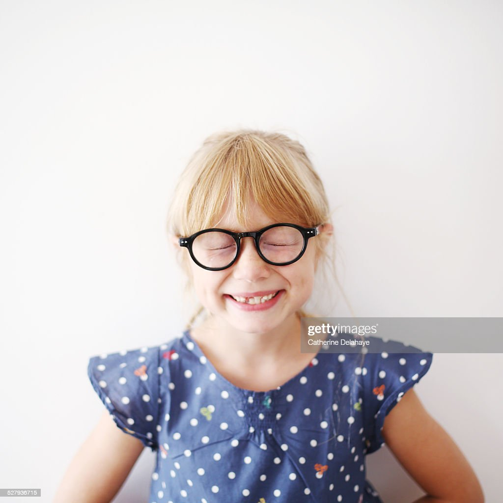 A 8 years old girl with glasses : Foto de stock