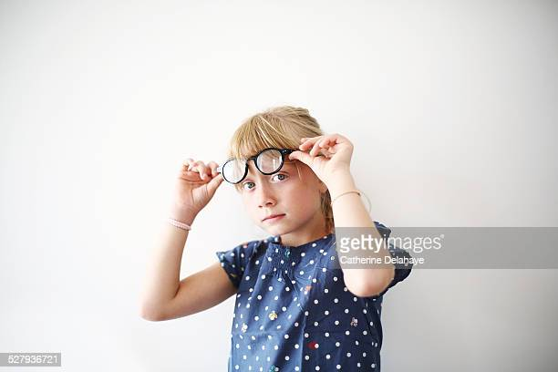 A 8 years old girl with glasses