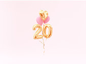 20 years old. Gold balloons number 20th anniversary
