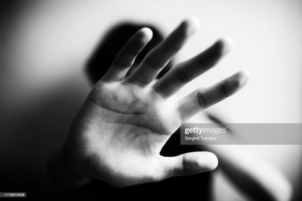 18 years old guy defends himself with his palm : Stock Photo
