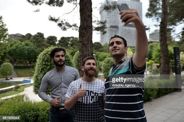 25 years old Iranian Lionel Messi lookalike university student Reza Parastesh poses for a photo with fans in Tehran Iran on May 11 2017 Reza grew a...