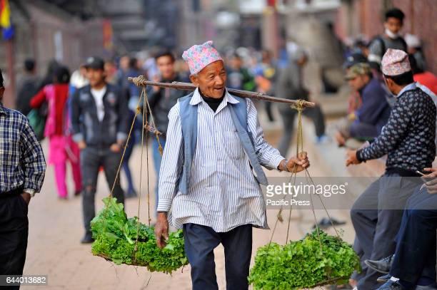 PATAN NEPAL KATHMANDU NP NEPAL 80 years old Jeet Lal Maharjan local farmer walks to sell fresh vegetables at Patan Durbar Square He used to earn NRs...