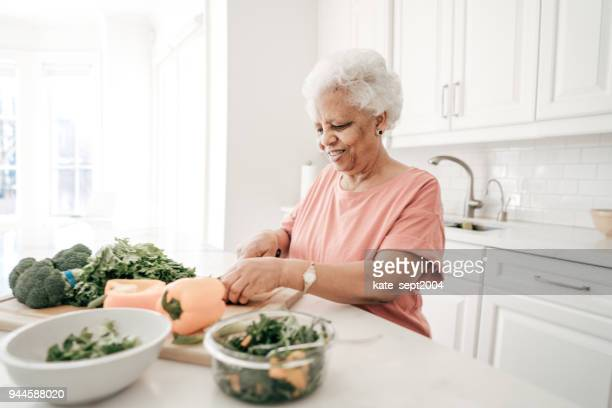 70 years old lady with healthy recipes - 65 69 years stock pictures, royalty-free photos & images