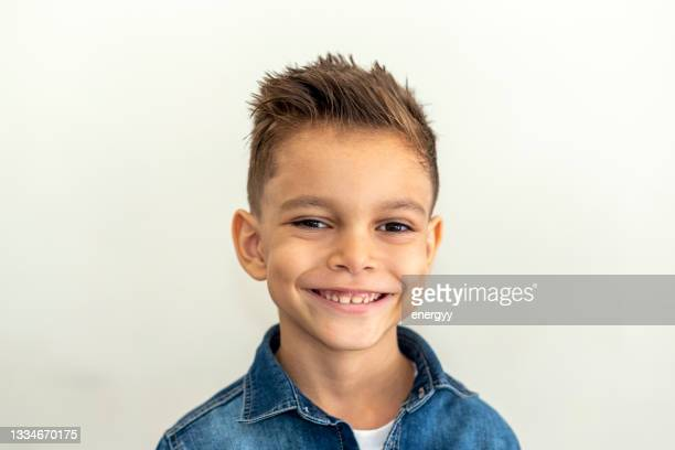 8 years old little boy with a happy cute smiling face - 8 9 years stock pictures, royalty-free photos & images