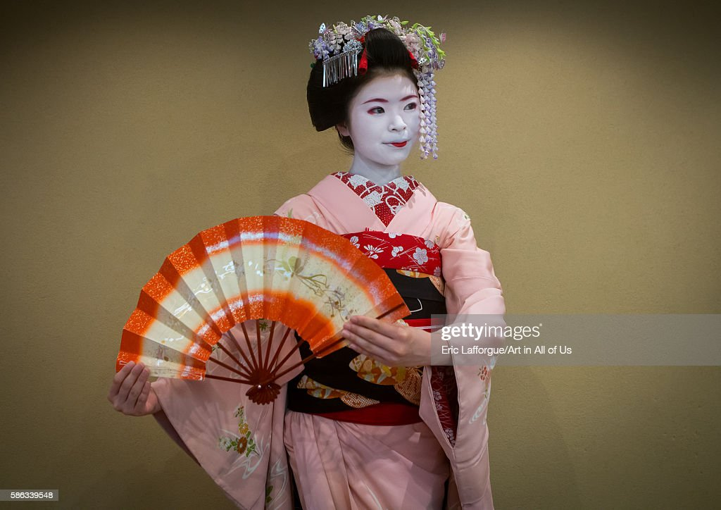 16 years old maiko called chikasaya dancing with a fan, kansai region, kyoto, Japan on May 27, 2016 in Kyoto, Japan.