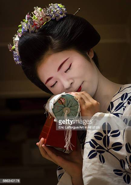 16 years old maiko called chikasaya with the pillow shes used to protect her hairstyle kansai region kyoto Japan on May 27 2016 in Kyoto Japan