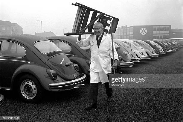 91 years old Mr Ernest Hawk Turner who celebrates his birthday still does a young man's job of work He prepares VW Beetles for delivery December 1969...
