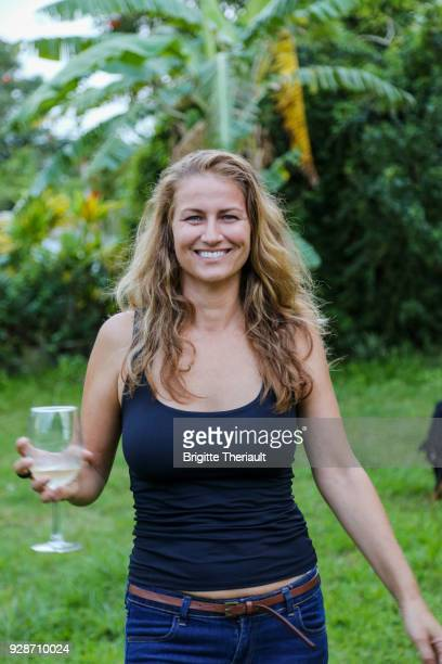 43 years old natural women look, drinking a glass of red wine