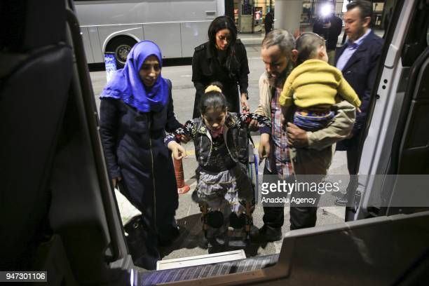 9 years old Palestinian congenital amputee girl Sejud receives help to get in a vehicle after she arrived at Esenboga International Airport with her...