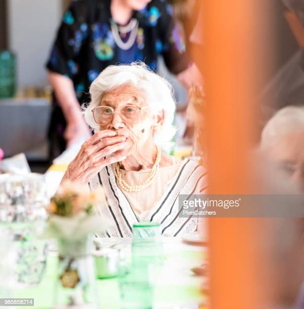 105 years old senior lady enjoys her lunch seated at dinning table in an old age home - over 100 stock photos and pictures