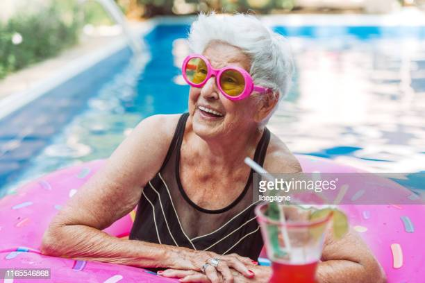 84 years old senior woman in the pool - old woman in swimsuit stock pictures, royalty-free photos & images