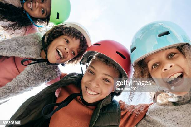 10-12 years old siblings with helmets having fun outdoor - 10 11 years stock photos and pictures