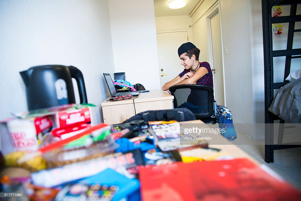 19 years old student girl working with laptop and smartphone : Stock Photo
