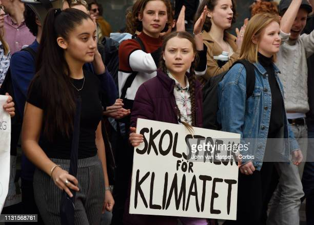 16 years old Swedish student and environmental activist Greta Thunberg leads a march at l'Opera against climate change on February 22 2019 in Paris...