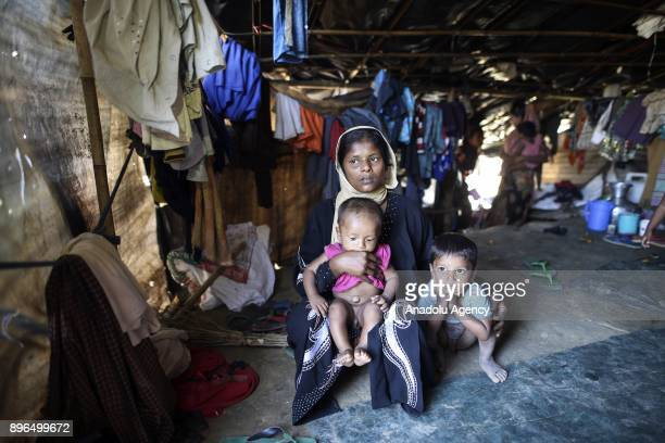 COX'S BAZAR BANGLADESH DECEMBER 19 32 years old Tahara poses with two children at a refugee camp in Cox's Bazar Bangladesh on December 19 2017...