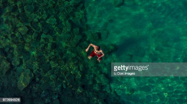 14-15 years old teenage boy relaxing in the sea - 14 15 years stock pictures, royalty-free photos & images