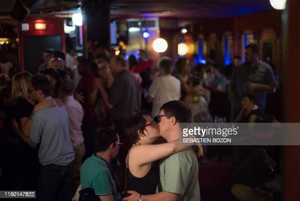 """Years old woman with mental disabilities, Sabrina Winne kisses her 31 years old boyfriend, Florent Wimmer , at the """"Club 1900"""" nightclub, in..."""