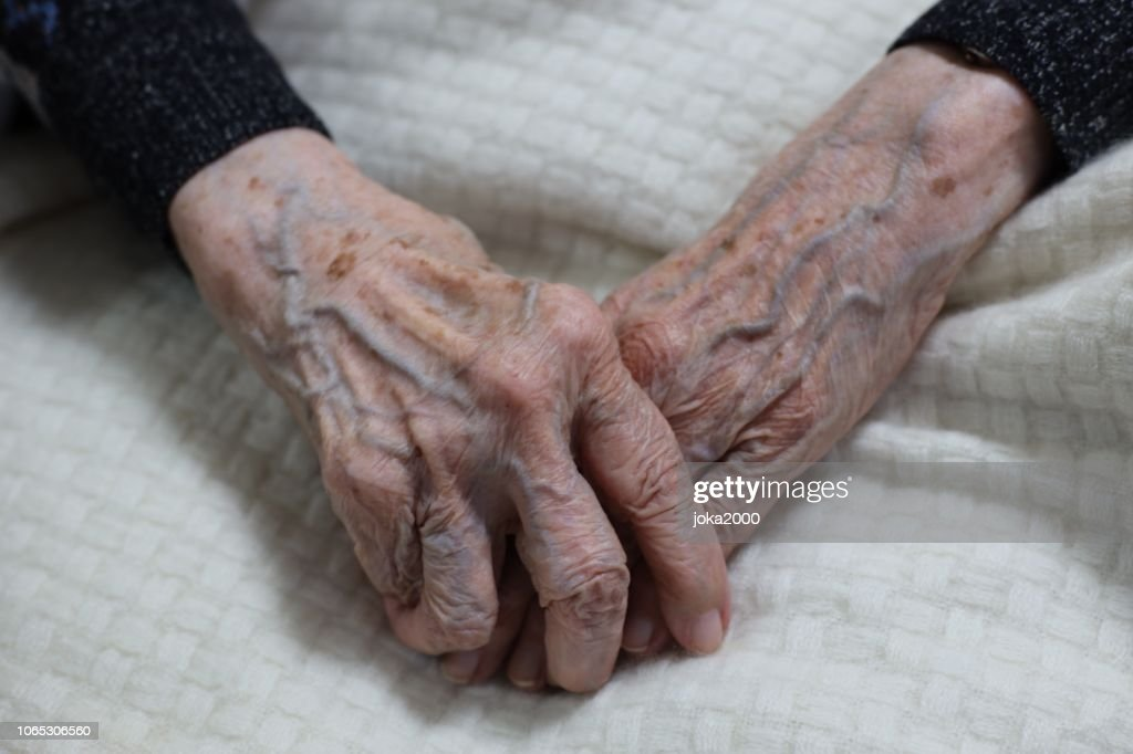 102 years old woman's hands : Stock Photo