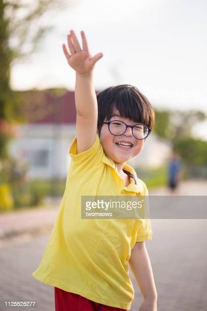 5 years old young boy waving. - waving stock pictures, royalty-free photos & images