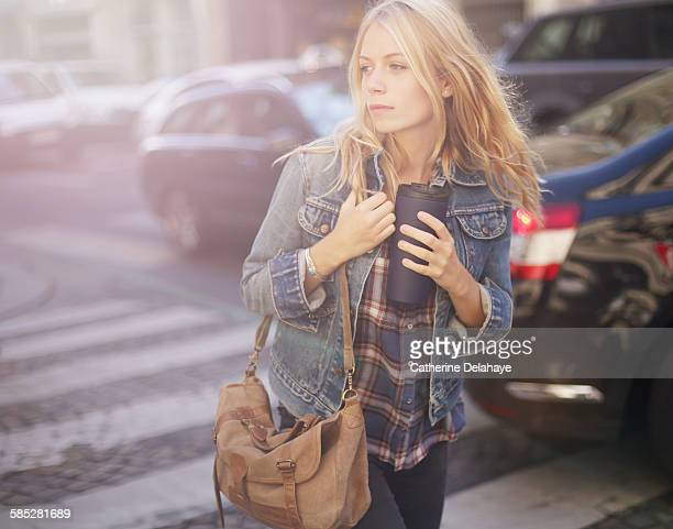 a 18 years old young woman walking in the street - 16 17 years stock pictures, royalty-free photos & images