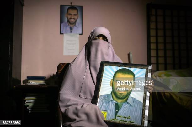 Eman Gomaa mother of Mosaab Elshamy a photojournalist who was killed during Rabaa dispersal on the 14th of August holds her dead son's portrait...