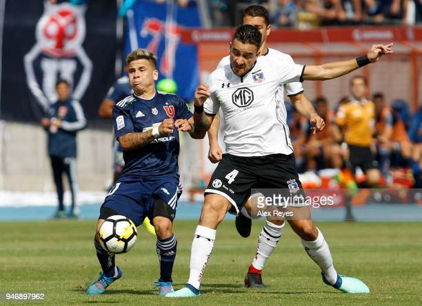 Yeferson Soteldo of U de Chile fights for the ball with Matias Zaldivia of Colo Coloduring a match between U de Chile and Colo Colo as part of Torneo...