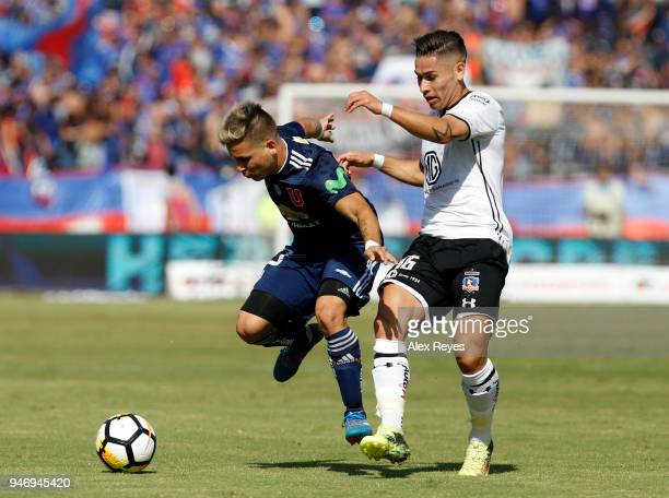 Yeferson Soteldo of U de Chile fights for the ball with Oscar Opazo of Colo Coloduring a match between U de Chile and Colo Colo as part of Torneo...