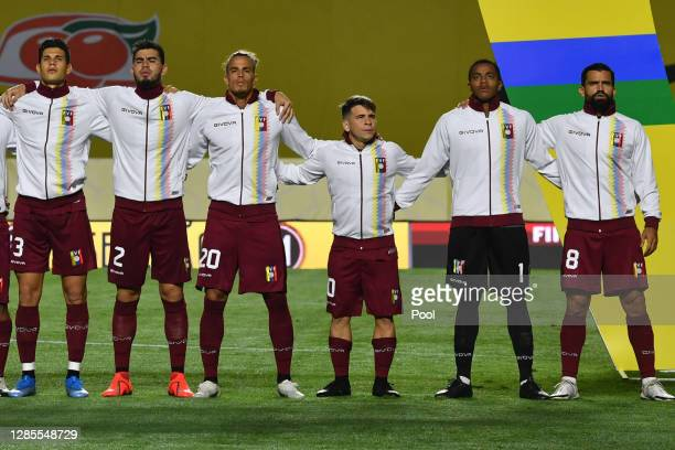 Yeferson Soteldo of Venezuela and teammates stand during national anthem during a match between Brazil and Venezuela as part of South American...