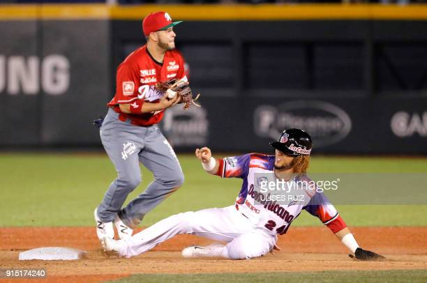 Yefri Perez Aguilas Cibaenas of Republica Dominicana tags out at second base Walter Ibarra Tomateros de Culiacan of Mexico during the Caribbean...