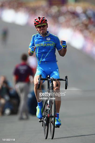 Yegor Dementyev of Ukraine celebrates winning gold in the Men's Individual C4-5 road race on day 8 of the London 2012 Paralympic Games at Brands...